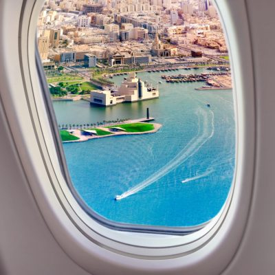 View from the airplane window on the Persian Gulf and Doha, Qatar